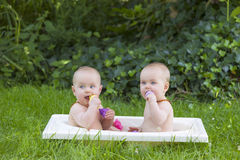 Twin sisters taking a bath Royalty Free Stock Images
