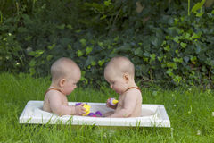 Twin sisters taking a bath Stock Image
