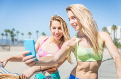 Twin sisters taking selfie in Los angeles on the beach walkway Stock Image