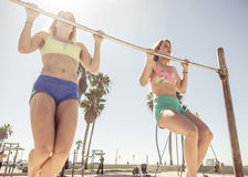 Twin sisters training in Venice beach Royalty Free Stock Photos