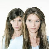 Twin sisters woman portrait Stock Images