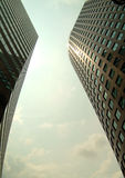 Twin skyscapers. Modern building from below. Modern building Royalty Free Stock Image