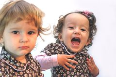 Twin smile. Twins, one serious , second with smile Royalty Free Stock Photos