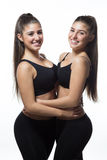 Twin smiling fitness-girl Royalty Free Stock Image