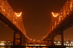 Twin Spans at Night. Twin spans of the Crescent City Connection bridges at night as they cross the Mississippi River in the port of New Orleans Stock Image