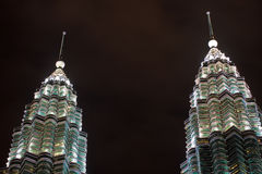 Twin Spires of Petronas Towers at Night Malaysia Royalty Free Stock Photos