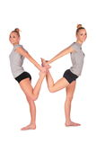 Twin sport girl balances back-to-back Stock Photos
