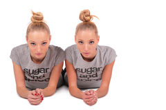 Twin sport girls lying stock images