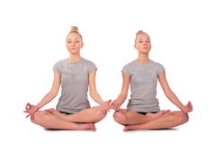 Twin sport girls meditating Stock Photography