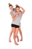 Twin sport girls posing royalty free stock images