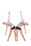 Twin sport girls side bend stock images