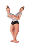 Twin sport girls stands Stock Images