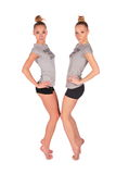Twin sport girls stands on tiptoe stock photography