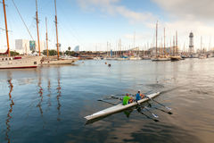 Twin sport racing rowing boat goes in Barcelona port harbor Stock Photo
