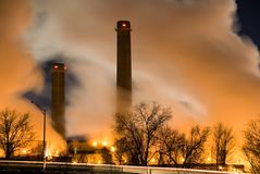 Twin stacks - power plant. Horizontal color image of coal fueled power plant with visible smoke stacks and columns of steam Royalty Free Stock Image