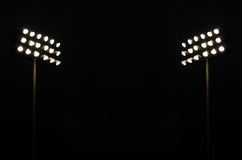 Twin Stadium lights. At A Sports Stadium At Night With Copy Space Stock Image