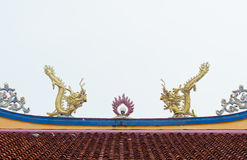 Twin statue of dragons on the roof Stock Images