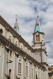 Twin steeples Iglesia de San Alfonso, Cuenca, Ecuador. Looking up at the blue-roofed twin steeples of Iglesia de San Alfonso cathedral in Cuenca, Ecuador, one of Royalty Free Stock Image