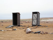 Twin toilets at Cape Cross in Namibia Royalty Free Stock Photos