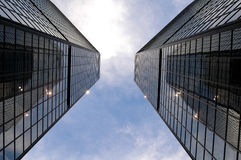 Twin Towers. The twin towers of the World Trade Center in Denver reflect on each other as they touch the sky Stock Photo