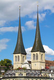 Twin towers of the church of St. Leodegar, Lucerne Stock Images
