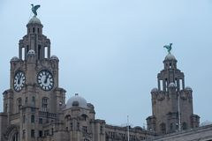 Twin towers on the Liverpool waterfront. LIVERPOOL, ENGLAND - NOVEMBER 5, 2018: The twin towers of the Royal Liver Building office block at the pier head on the stock photo