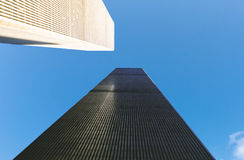 Twin towers in New York under blue sky. NEW YORK CITY - NOV 26: The twin towers of the World Trade Center and lower Manhattan on November 26, 1998 in New York stock photography