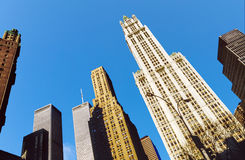 Twin towers in New York under blue sky. NEW YORK CITY - NOV 26: The twin towers of the World Trade Center and lower Manhattan on November 26, 1998 in New York royalty free stock photo