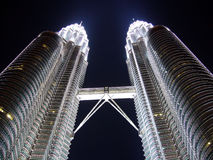 Twin towers at night. Looking up at the bridge connecting two Petronas Twin Towers at night Royalty Free Stock Photo