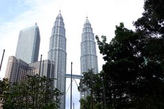 Twin Towers. Petronas KL KualaLumpur KLCC citylife city park buildings lowangleview Royalty Free Stock Photography