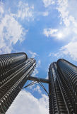 Twin towers, sky and sun - Kuala Lumpur Royalty Free Stock Photography