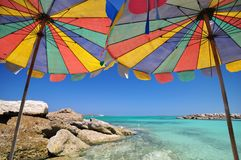 Sea and umbrella. The twin umbrella with beautiful beach and clear sky royalty free stock image