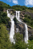 Twin waterfall cascading down a mountainside Stock Image