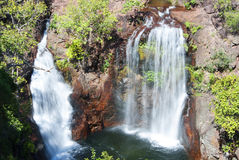 Twin waterfalls. Water cascading over rocks into a pool Royalty Free Stock Photo
