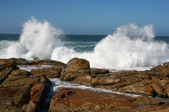 Twin waves splashing Stock Photo