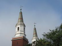 Twin white church steeples in the morning sun. stock photos