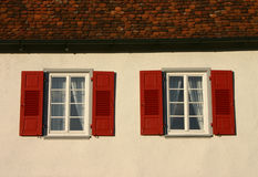 Twin windows. Windows and roof of a small castle stock photos