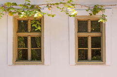 Twin windows on old house Royalty Free Stock Image