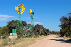 Twin windpumps in Namibia Royalty Free Stock Photo
