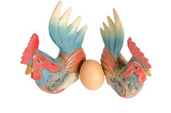 Twin wood chicken. Two wood carving chicken and egg Royalty Free Stock Photos