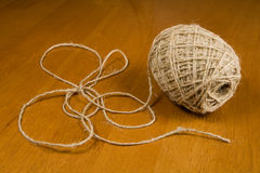 Twine. Unwind twine on a desk Royalty Free Stock Photography