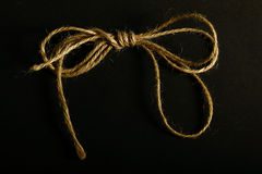 Twine on black background Royalty Free Stock Photos