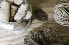 Twine, leaf skeletons and corks Royalty Free Stock Photography