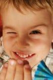 Twinkle boy. Twinkle fun boy face closeup stock image