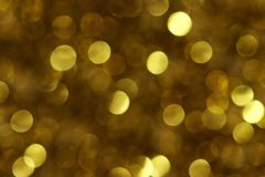 Twinkle of golden shine with glitter. Background of golden shine stars with glitter light Stock Image