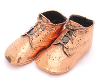 Twinkle toes. Polished bronzed baby shoes Royalty Free Stock Images