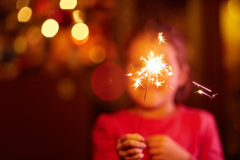 Twinkle twinkle. A happy little girl playing with a sparkler stock images