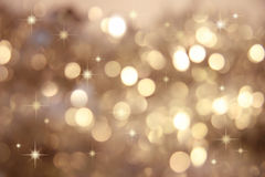 Twinkle, twinkle little stars/Gold. Abstract background of holiday lights royalty free stock photo