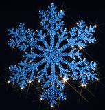 Twinkling blue snowflake Stock Images
