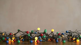 Twinkling garland on a wooden table stock video footage